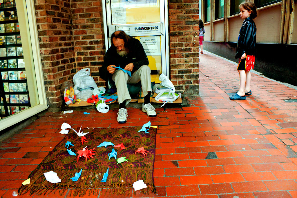 Man-doing-origami--Brighton