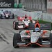 Ryan Briscoe leads Sebastien Bourdais into Turn 4 at Belle Isle