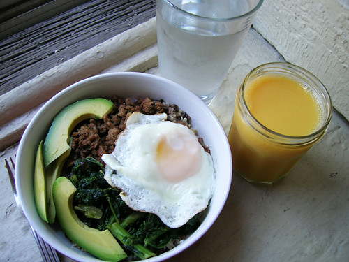 trader joe's rice medley, chinese ground pork, kale, fried egg, avocado, OJ and water
