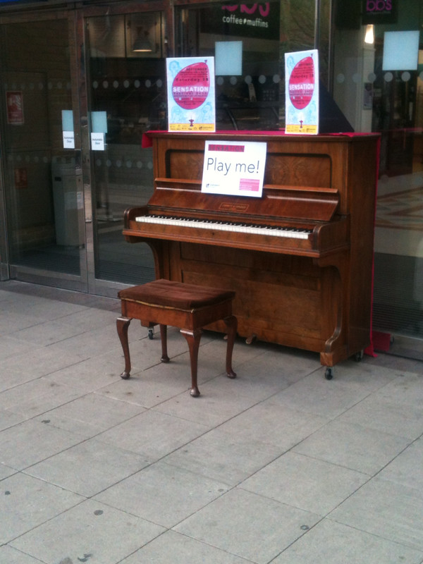 Piano with play me sign