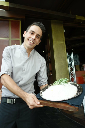 A friendly waiter presenting the Salt Crusted Whole Fish to every table at Catalunya Sundays Brunch with Passion