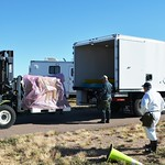 Toxic material handlers move 105mm boxed munitions out of storage at the U.S. Army Pueblo Chemical Depot for delivery to the Pueblo Chemical Agent-Destruction Pilot Plant, where they will undergo a process called Baseline Reconfiguration.