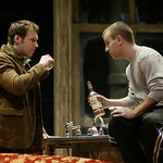 Brian Hutchison as Burton and Nat DeWolf as Larry share a drink (and some insights) in Huntington Theatre Company's production of Lanford Wilson's Burn This at the BU Theatre/Avenue of the Arts. Part of the 2004-2005 season. Photo: T. Charles Erickson