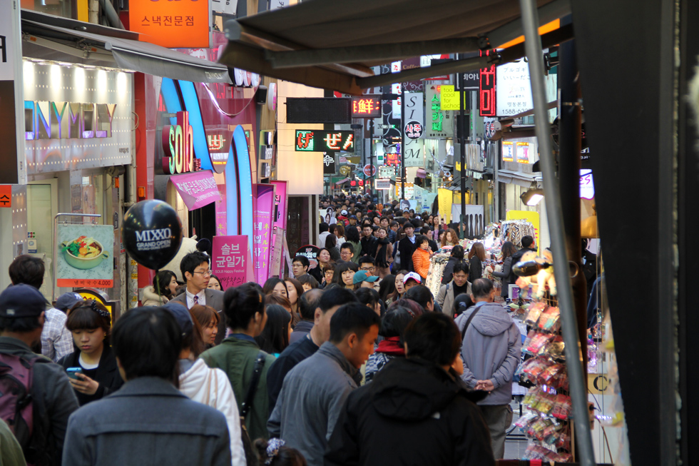 Crowds of shoppers and walkers in Myeongdong, Seoul, South Korea