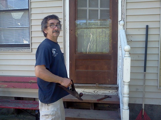 "Installing the ""New"" screen door..."