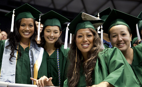 <p>University of Hawaii at Manoa graduates at the campus' commencement ceremony at the Stan Sheriff Center. May 11, 2013 (Photos by Tim Ing)</p>