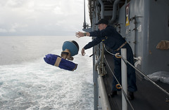 Lt.j.g. Jeffrey Grabon launches a global drifter buoy in the Pacific Ocean from USS Pearl Harbor (LSD 52), May 28. (U.S. Navy Photo by Mass Communication Specialist 1st Class Lowell Whitman)