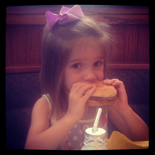 her 1st fast food burger. that she's actually eating.