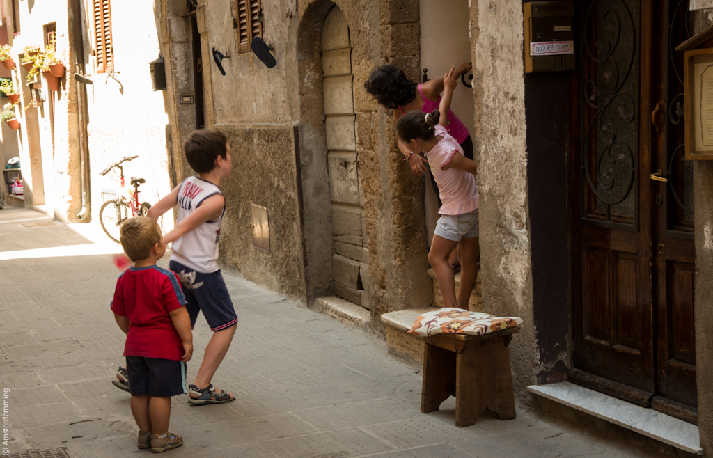 Italy, Children Playing in Pitigliano