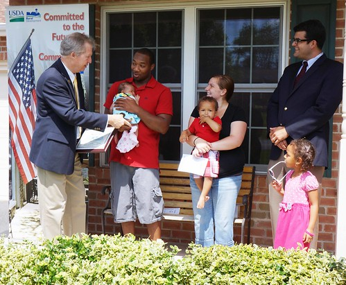 Pennsylvania Rural Development  State Director Tom Williams (far left) and Acting Administrator for Rural Business Services John Padalino (far right), celebrated National Homeownership Month with Rural Development Housing Loan Recipient Willie Hall and his family at their new  home in Chambersburg.
