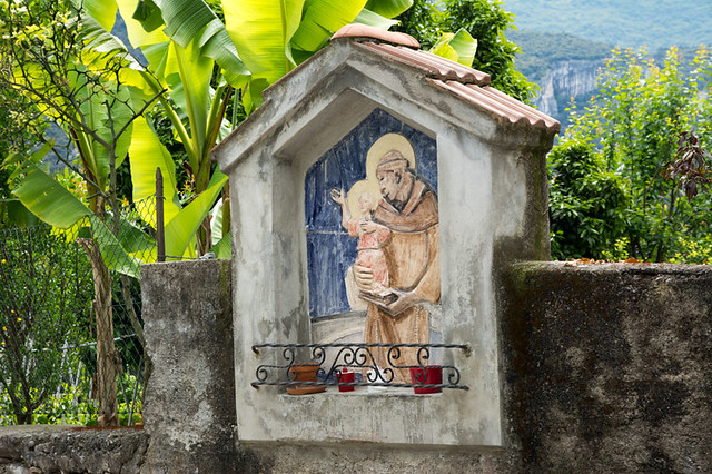 italian shrine with saint and baby jesus