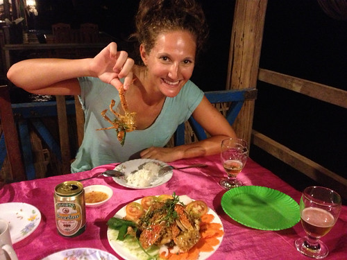eating fresh crab topped with amazing kampot green pepper corn sauce in Kep, Cambodia