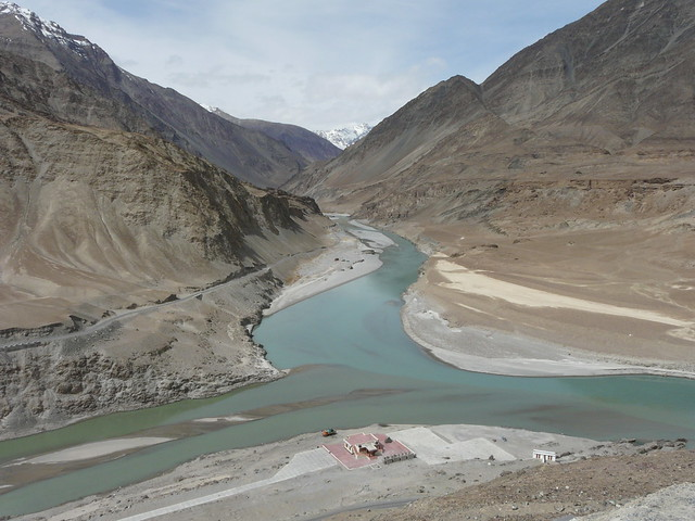 The Zanskar and the Indus meet, the two rivers slowly merging together