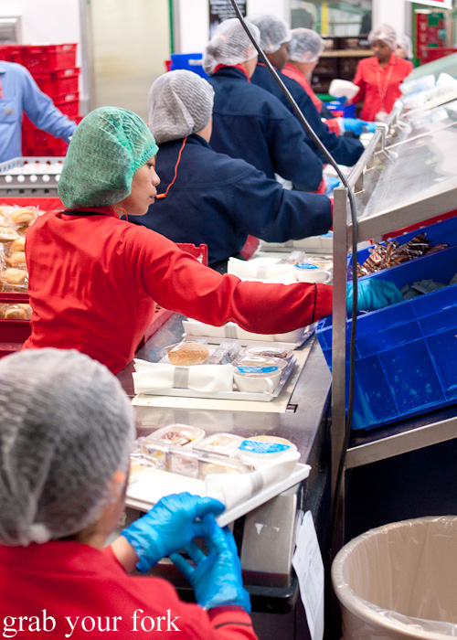 Assembly line for Economy Class meal trays during a behind-the-scenes tour of Emirates Flight Catering