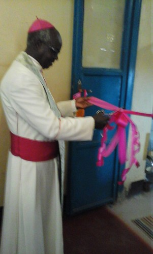 Bishop cutting ribbon of maternity