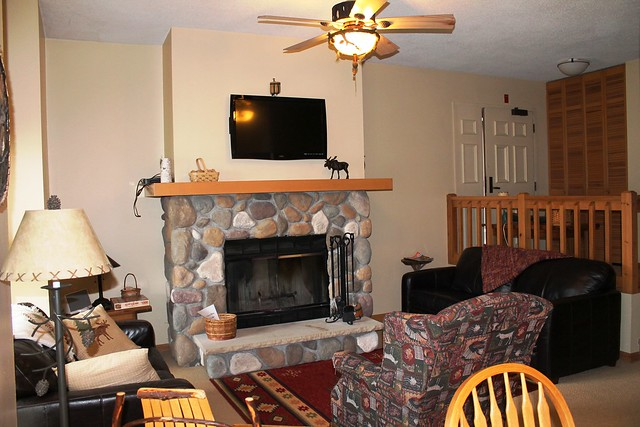 Direct lake front condominium at Whiteface Club Resort. Stone fireplace in the living area.