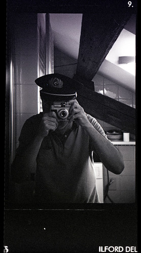 reflected self-portrait with Bencini Koroll II camera and pilot's hat by pho-Tony