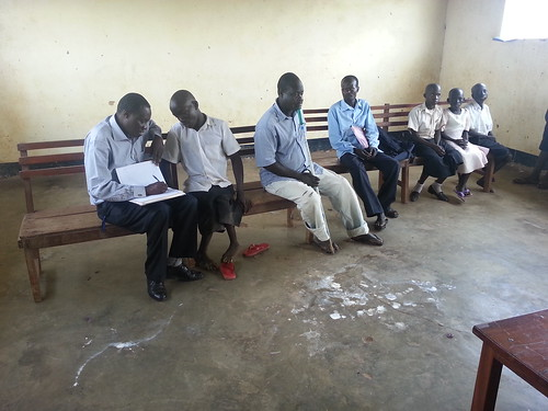 GDPU Program Coordinator Patrick Ojok checks in on participants of Inclusive Disability Sports in their communities