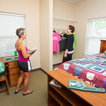 c05 -- JULY: Students check out a bedroom during an open house for The Gates student apartment buildings.