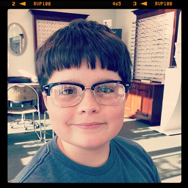 New glasses for Logan... apparently geek glasses are in fashion and Logan likes them. Mom, not so much...sigh. ..
