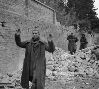 German soldiers surrendering to personnel of The Edmonton Regiment / Des soldats allemands se rendent aux membres de l'Edmonton Regiment