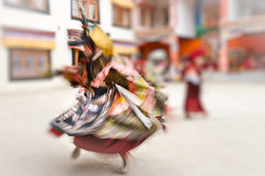 A Buddhist monk whirls during a sacred dance.