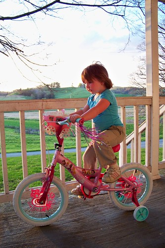 Lucy riding her new bike.