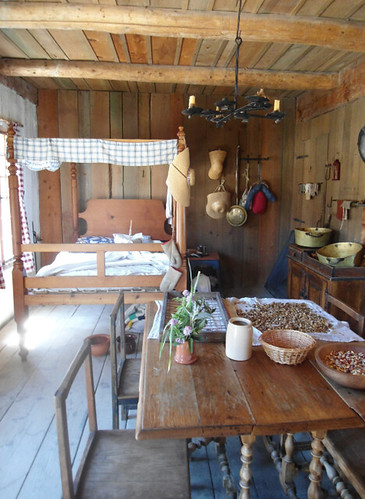 period cooking ingredients and kitchen paraphernalia on a table in a reconstructed row house at Fort Michilimackinac
