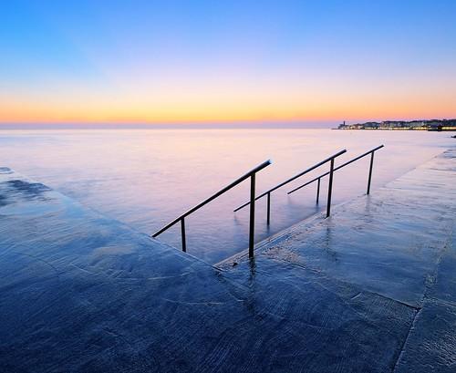 blue light sunset sea beach stairs concrete coast slovenia after piran pirano