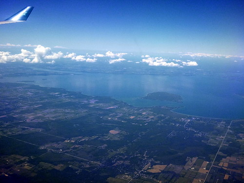 Shot from out the airplane window, flying above Toronto