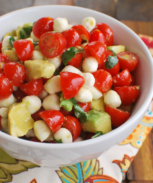 Mozzarella, Tomato, Avocado Salad - cherry tomatoes, fresh mozzarella, avocado, and fresh herbs tossed in a light lemony dressing. Perfect summer side dish or pile it on grilled chicken!