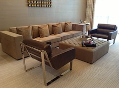 wood(0.0), loveseat(0.0), bed(0.0), hardwood(0.0), floor(1.0), furniture(1.0), room(1.0), laminate flooring(1.0), table(1.0), living room(1.0), interior design(1.0), couch(1.0), wood flooring(1.0), studio couch(1.0), chair(1.0), flooring(1.0),