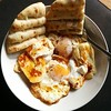 Sunday brunch. Turkish-style fried eggs and yogurt with haloumi and pitta :egg:.