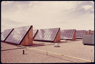Flat plate solar heating collectors built by the Solaron Corporation, and installed on the roof of the Gump Glass Company..., 05/1975.