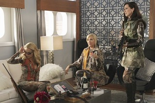 three of the women on GCB getting ready for a hunting trip