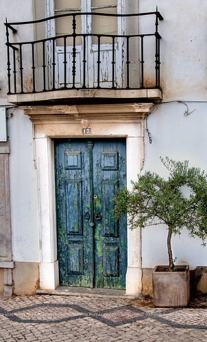 Tavira green door with tree by Alida's Photos