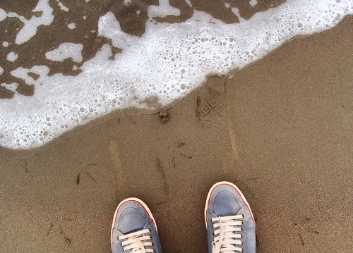 statutory feet on beach shot