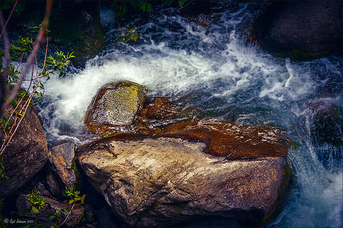 Image of water flowing past a rock at Iao Valley in Maui