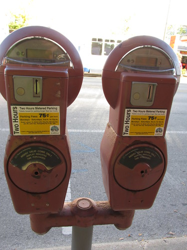 Parking meters. A vanishing urban icon on Chicago area streets.  Evanston Illinois.  Wednsday, October 2nd, 2013. by Eddie from Chicago