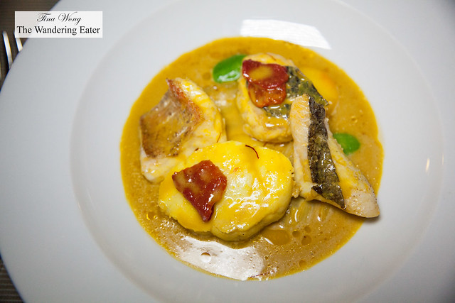 Second service of Bouillabaisse - rich saffron broth, rockfish fillets, tomatoes