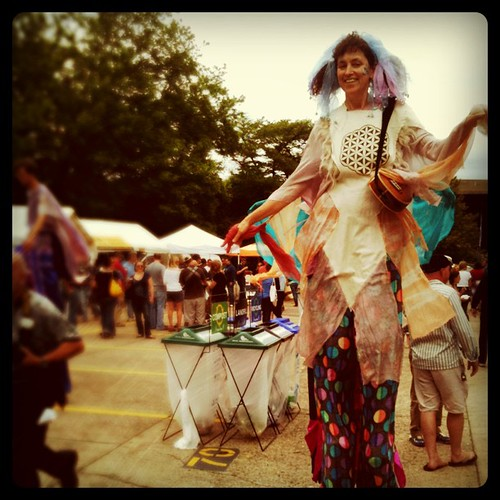 earth day stilt hippies dancing to prince... around the recycle bins #ashevilleweekend