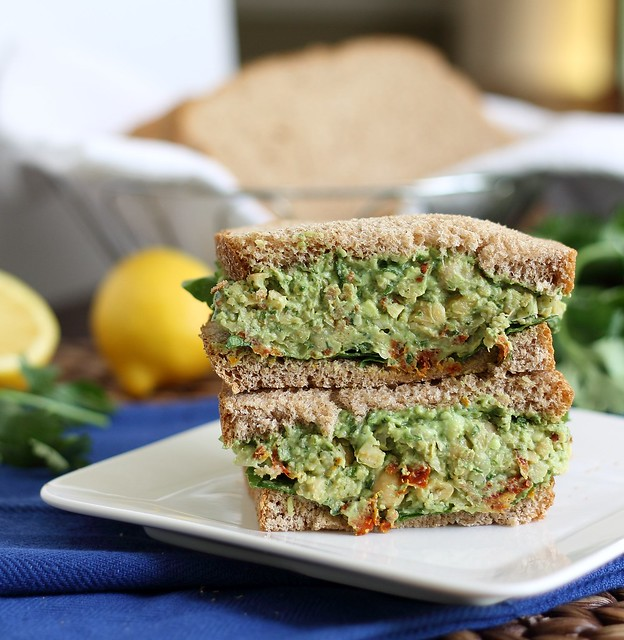 A sandwich filled with chickpea pesto