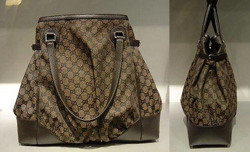 2.)  $468.30 Brown and Black GG Canvas Full Moon Tote