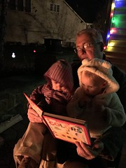 Daddy reading to the twins by the fire