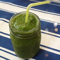 @emmaredvelvet First day of green smoothie challenge: kale, frozen peaches, fresh green grapes, and a bit of water