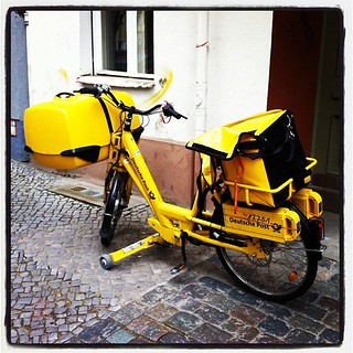 Yellow newspaper bike