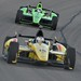 Graham Rahal leads Dario Franchitti in Turn 1