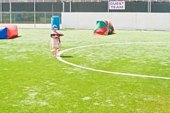 ball(0.0), sport venue(0.0), kick(0.0), sports(0.0), baseball field(0.0), football(0.0), ball game(0.0), flooring(0.0), stadium(0.0), ball(0.0), grass(1.0), play(1.0), artificial turf(1.0), player(1.0), net(1.0), lawn(1.0),