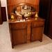 Dark wood mirrored sideboard