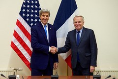 U.S. Secretary of State John Kerry shakes hands with French Foreign Minister Jean-Marc Ayrault on December 6, 2016, before a bilateral meeting as they both attend a North Atlantic Treaty Organization Ministerial Session at the alliance's headquarters in Brussels, Belgium. [State Department Photo/ Public Domain]
